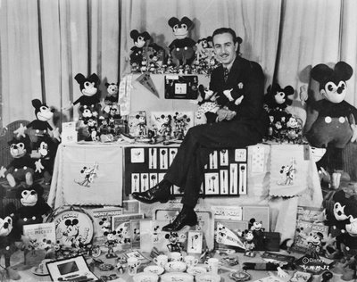 8_Walt Disney sitting with Mickey Mouse merchandise
